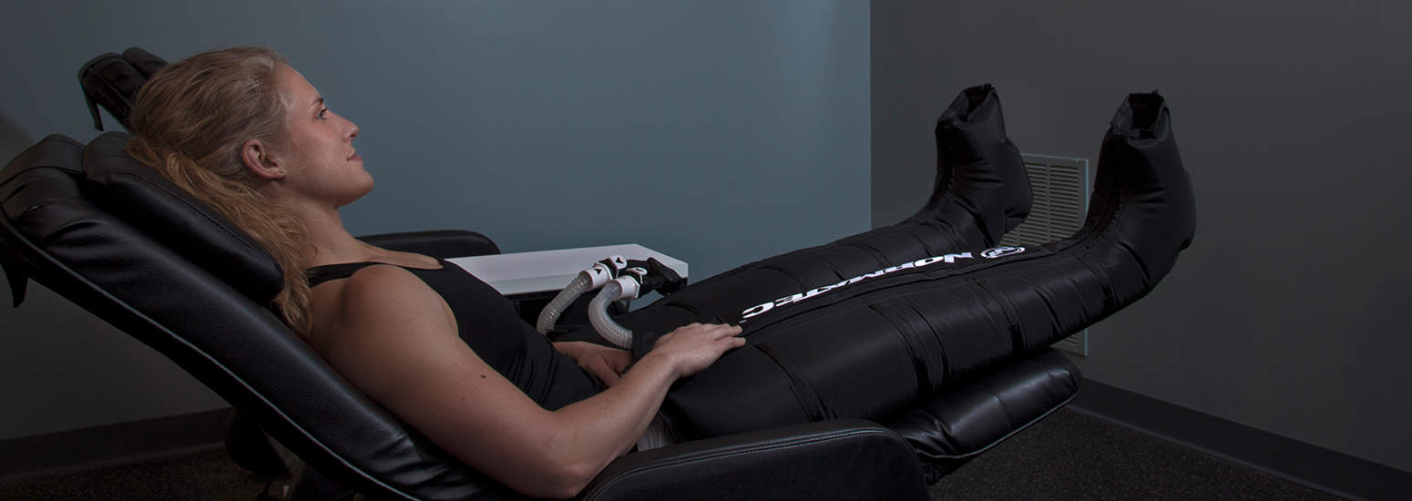 Woman receiving Normatech Therapy