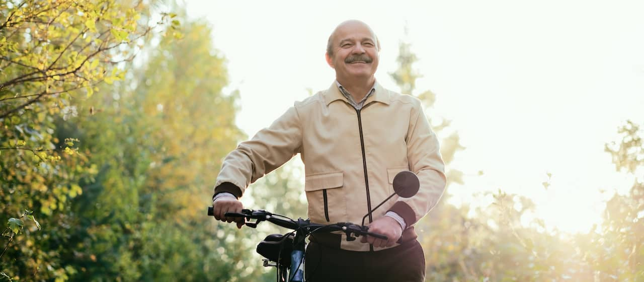 Senior on Bicycle - Arthritis Treatment